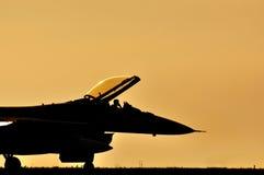Kampfflugzeugsonnenuntergang Stockfoto