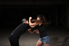 Kampfkunstfrauausbilder Stockfoto