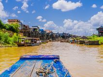 Kampong Phluk floating village, Tonle Sap lake, Siem Reap Province, Cambodia. Exotic Kampong Phluk floating village with stilt houses and multicolored boats royalty free stock photo