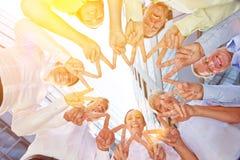 Kamratskap och solidaritet med händer som bildar stjärnan Fotografering för Bildbyråer