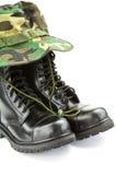 Kamuflażu wojskowego i kapeluszu buty Zdjęcie Stock