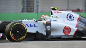 Kamui Kobayashi участвуя в гонке в F1 Сингапур грандиозном Prix Стоковое Изображение