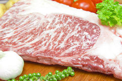 Kamui Wagyu Beef Strip Lloyd marble high red meat on a plate with fresh vegetables. Royalty Free Stock Image
