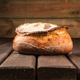Kamut bread. Kamut round bread made with sourdough on a wooden table board stock photography