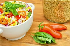 Kamut salad with fresh, raw vegetables Stock Images
