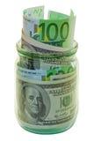 Kan met geld Stock Foto's