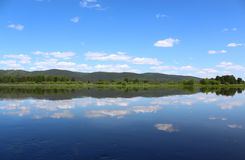 Kan River reflects the sky and clouds, the Krasnoyarsk Territory Stock Photo
