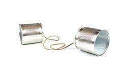 kan tin för kommunikationsbegreppstelefonen Royaltyfri Foto