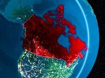 Kanada i rött på natten Royaltyfri Foto