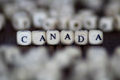 Kanada słowo na drewnianych sześcianach Fotografia Stock