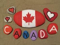 Kanada souvenir på kulöra stenar Arkivfoto