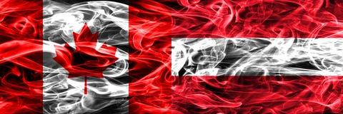 Kanada vs Österrike rök sjunker den förlade sidan - förbi - sidan Kanadensare och royaltyfria foton