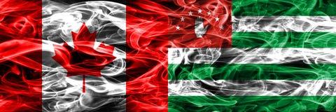 Kanada vs Abchazien rök sjunker den förlade sidan - förbi - sidan Kanadensare och royaltyfri foto
