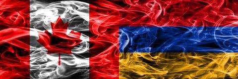 Kanada vs Armenien rök sjunker den förlade sidan - förbi - sidan Kanadensare och royaltyfri foto