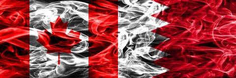 Kanada vs Bahrain rök sjunker den förlade sidan - förbi - sidan Kanadensare och royaltyfri bild