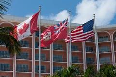 Kanadensare, britt och U S bris flags flyg royaltyfria bilder