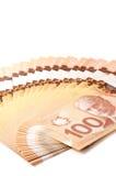 Kanadensare 100 dollarräkningar i polymer Arkivbilder