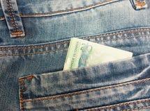 Kanadensisk dollar i ett jeansfack Arkivbilder