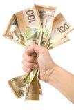 kanadensiska dollar full hand Arkivbilder