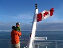 Kanadische Markierungsfahne mit Familie Stockfotos