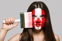 Kanadyjczyk flaga malująca na twarzy obraz stock