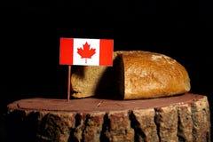 Kanadyjczyk flaga na fiszorku z chlebem zdjęcie royalty free