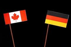 Kanadyjczyk flaga z niemiec flaga na czerni zdjęcia royalty free