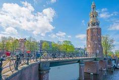 Kanal i staden av Amsterdam i vår royaltyfria bilder