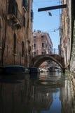 Kanal med gondoler i Venedig Fotografering för Bildbyråer