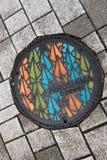 Kanaldeckel in Hiroshima Lizenzfreies Stockbild
