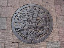 Kanaldeckel in Imabari, Ehime-Präfektur, Japan Lizenzfreies Stockbild