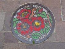 Kanaldeckel in Kumamoto, Japan Stockbilder