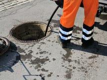 Kanalisationsarbeitskraft Stockfotografie