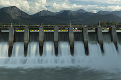 Kananaskis Hydro Electric Dam m2. Wide time exposure of the spillway on the Kananaskis hydroelectric dam on the Bow River, with Canadian Rockies in the Stock Photos
