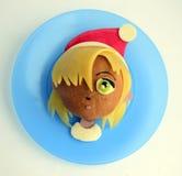 Kanapka w postaci dziewczyny ` s głowy w Santa ` s nakrętce Fotografia Royalty Free