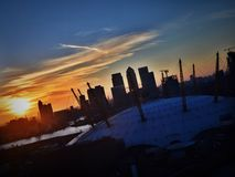 Kanarie Warf bij Zonsondergang Stock Foto's