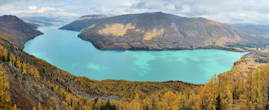 Kanas Lake in Panorama View. Kanas is Mongolian for The Lake in the Canyon. This is a eight-photo shot of Kanas Lake at the viewing pavilion. Xinjiang, October royalty free stock image