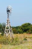Kanasas Sunflowers and Windmill Stock Image