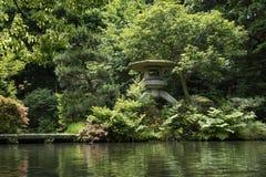 Kanazawa - Japan, June 9, 2017: Historical stone lantern covered. With moss in the garden of Oyama ninja Shrine Stock Photos