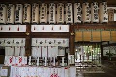 Kanazawa - Japan, June 9, 2017: Interior of the Oyama jinja Shrine with lanterns and bottles of sake as a gift to the shrine royalty free stock image