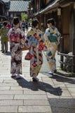 Tourists and women in kimono walking in the historical Higashi Chaya District Stock Photo