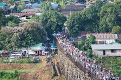 Kanchanaburi, Thailand - Aug 13 2017 : Tourists crowd travel on wooden mon bridge. In holiday stock images