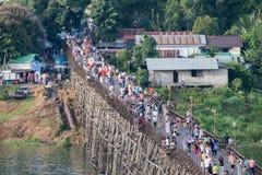 Kanchanaburi, Thailand - Aug 13 2017 : Tourists crowd travel on wooden mon bridge. In holiday stock photography