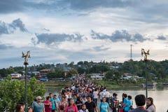 Kanchanaburi, Thailand - Aug 12 2017 : Tourists crowd travel on wooden mon bridge. In holiday stock images