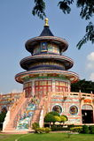 Kanchanaburi, Thailand: Chinese Temple. The glorious circular Qing Shou Si Chinese temple with its colourful painted walls, grand staircase, and bas relief Royalty Free Stock Photos