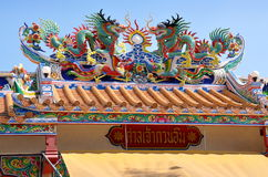 Kanchanaburi, Thailand: Chinese Temple. Colourful glazed dragons sit atop the roof of a small Chinese temple on historic Song Kwai Road / Heritage Walk in Royalty Free Stock Photos