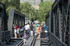 KANCHANABURI, THAILAND - DECEMBER 12: The Bridge Over The River Kwai With Tourists On It In The Town Of Kanchanaburi, Thailand Stock Photography
