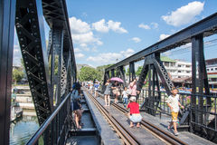 KANCHANABURI, THAILAND - DECEMBER 12: The Bridge over the River Kwai with tourists on it in the town of Kanchanaburi, Thailand. Taken on the 12th December, 2015 Royalty Free Stock Image