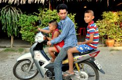 Kanchanaburi, Thailand: Family on Motorcycle Stock Photography
