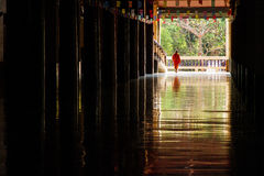 Kanchanaburi, Thailand - February 14, 2015: Novices are walking out of the temple go to home Stock Photo